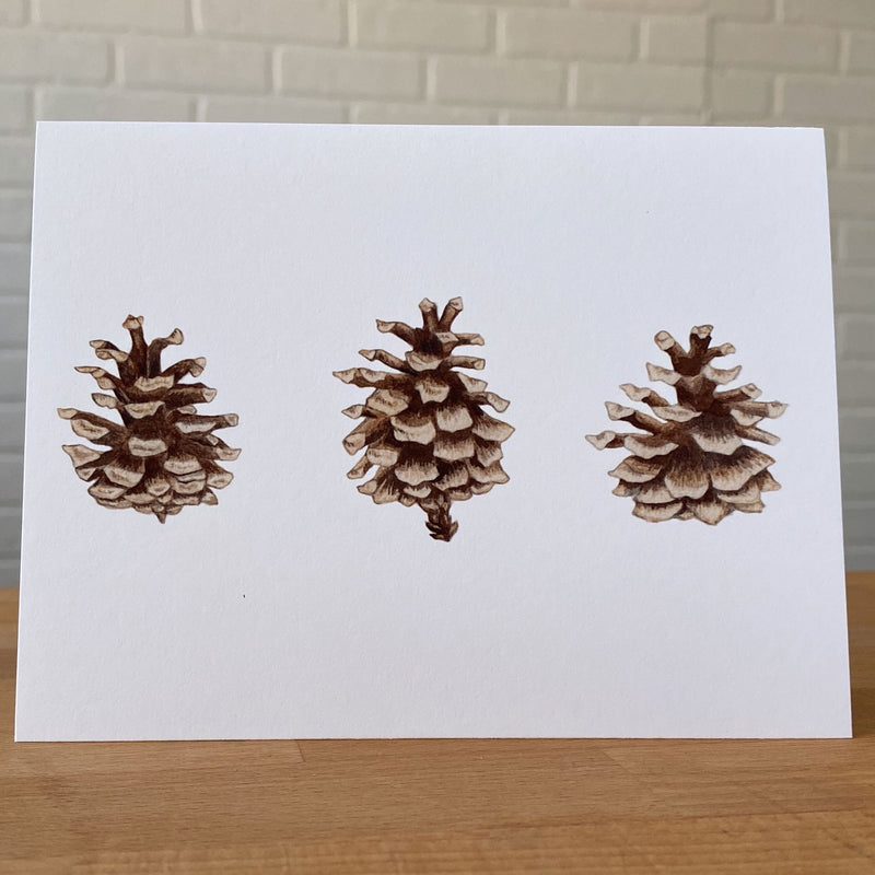 Watercolor card with three pinecones