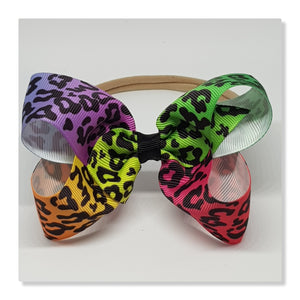 4 Inch Boutique Bow on Nylon Headband - Cheetah