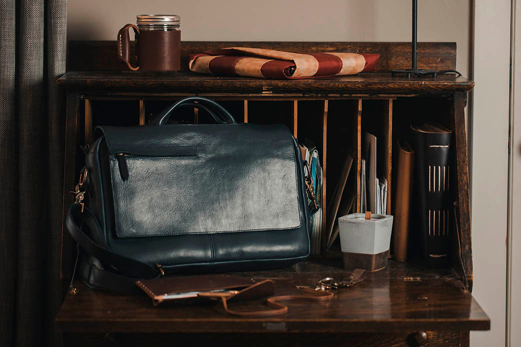 navy messenger leather bag