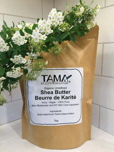 Shea butter from Ghana in a paper pouch, with flowers in foreground