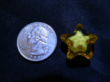 Little Star next to quarter