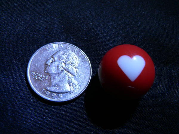 Heart Globe next to quarter
