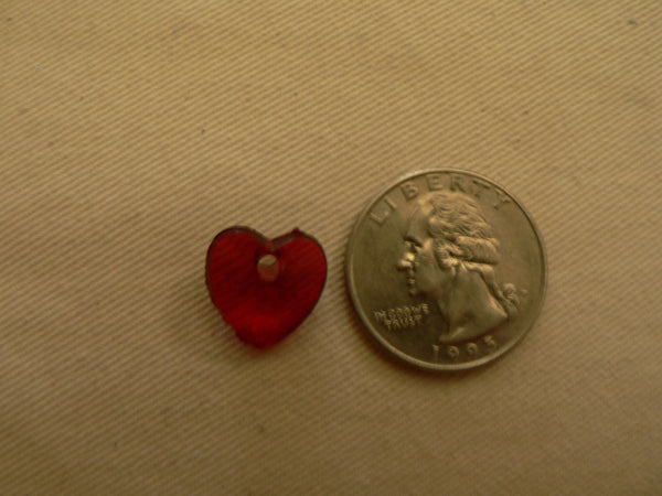 little heart bead next to a quarter