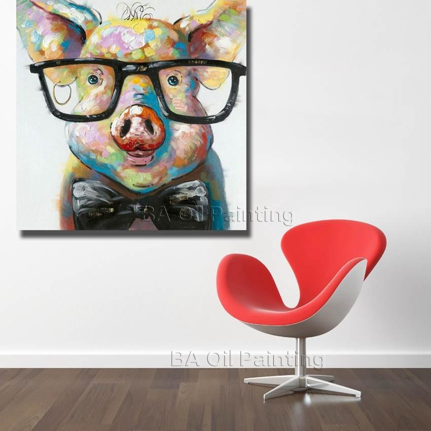Pig wearing glasses painting canvas near chair