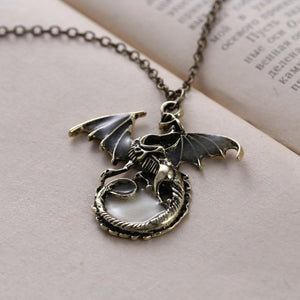 dragon pendant glow in the dark on book