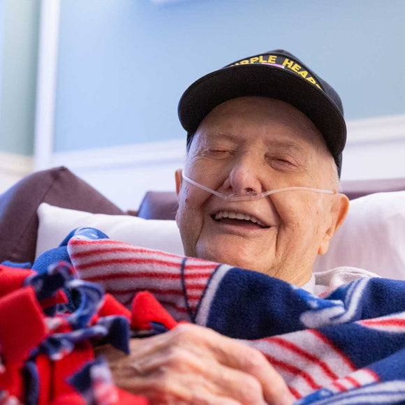Pictured is Marty, a WWII veteran and hospice patient who served in the Battle of the Bulge.