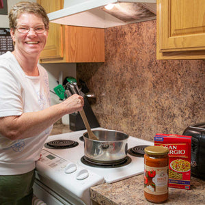 Pictured is Holly cooking one of the cottage's favorite meals - pasta.