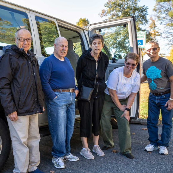 Pictured are Scotty, Howard, Beth, Holly and Joe standing by the cottage's transportation van.