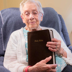 Pictured is 96-year-old Elizabeth with her large print Bible, which she reads each day.