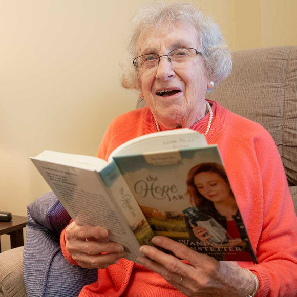 Pictured is Carolyn, who likes to read inspirational books with happy endings.