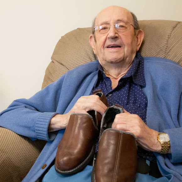 Pictured is Art posing with his favorite pair of slippers, which he uses daily.