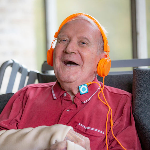 Pictured is John listening to country music on his iPod.