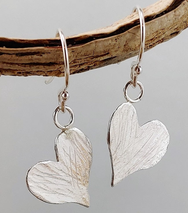 Asymmetric hammed heart earrings