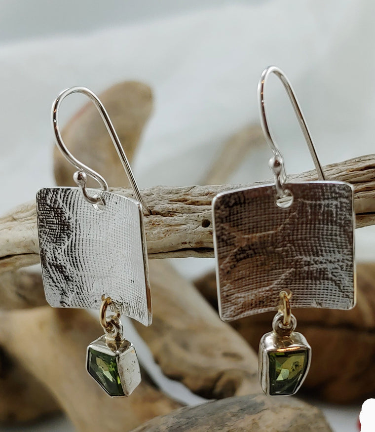 Roll printed silver earrings with faceted Peridot