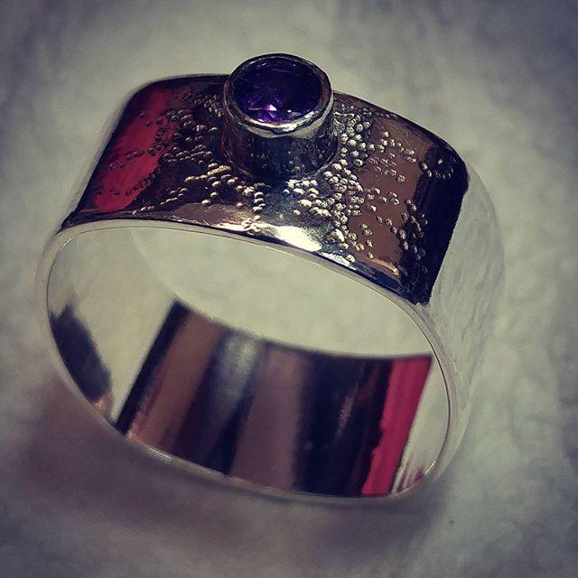 Squared band ring with hand textured detailing and Amethyst