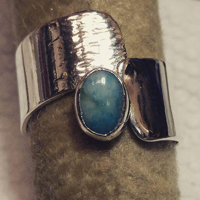 Wide band ring with Off-set Larimar
