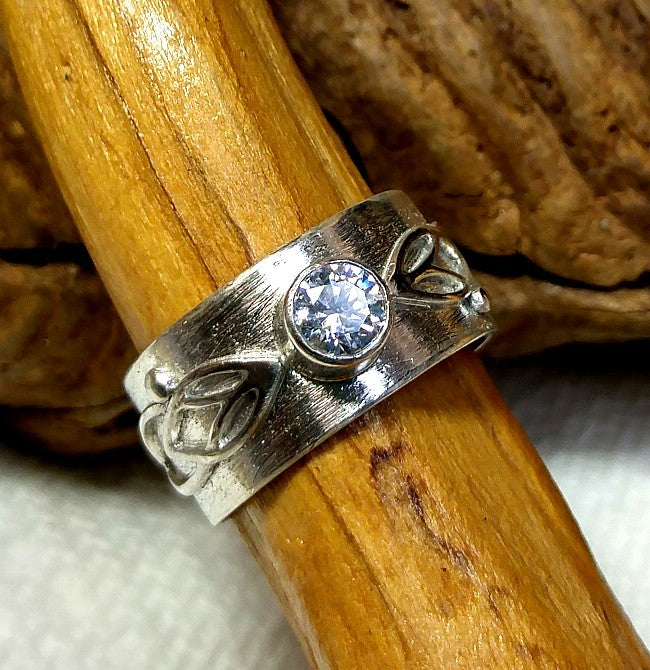 Sterling band ring with overlaid art nouveau elements and 4.5mm swarovski cz