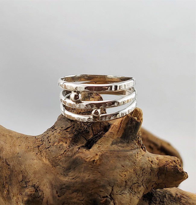 Three strand wrap ring with granulation