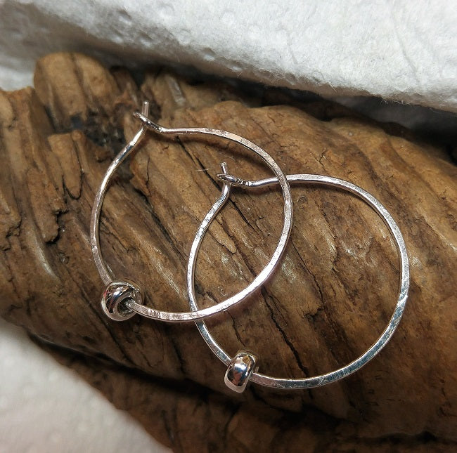 Hammered sterling hoops with sterling bead