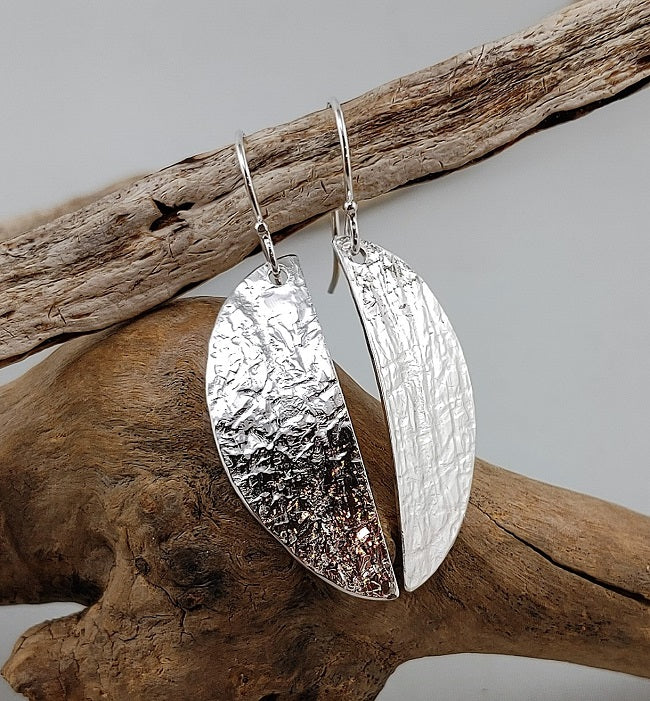 Asymmetric silver roll print earrings