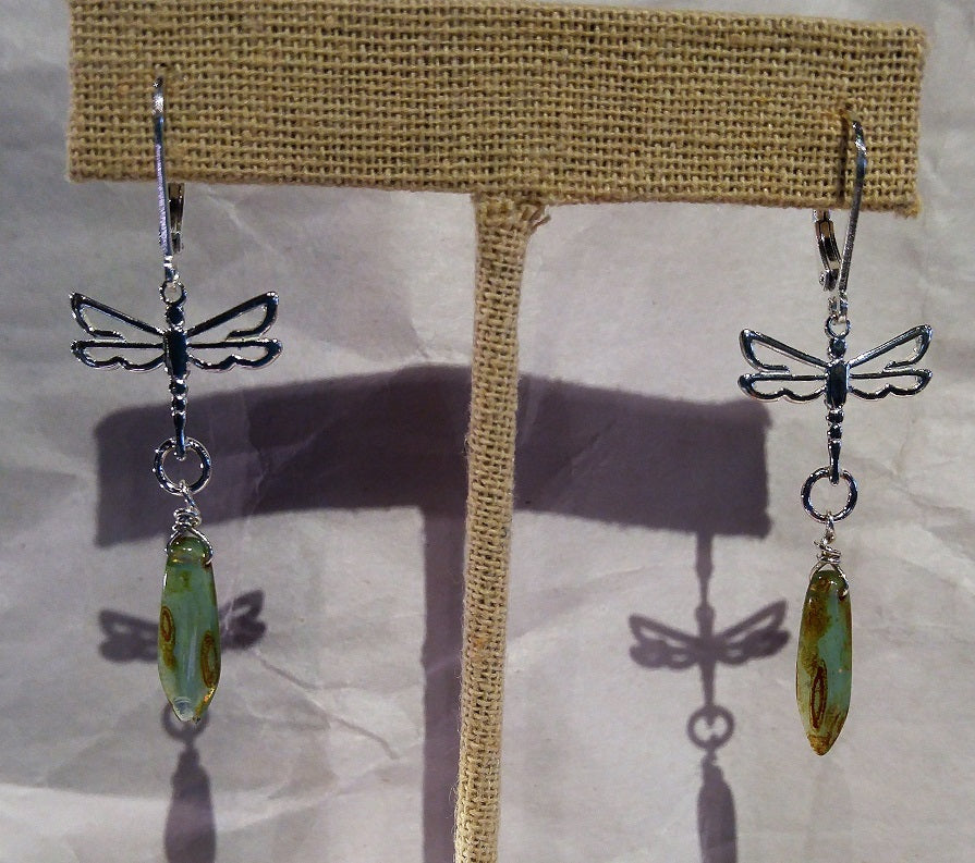 Dragonfly earrings with long glass dagger bead