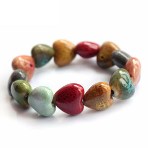 close-up of the Colorful 'His Steadfast Love' Ceramic Heart bead Bracelet on white
