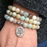 very close-up of the Tree of Life Wrap Amazonite Bead Bracelet on Model's wrist