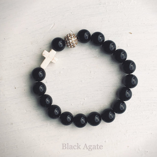 product top-view of the Natural Stone 'Thou Art With Me' Black Agate with Ivory Cross Bead Bracelet