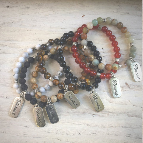 top view of all blessed natural stone bracelet styles grouped together in a colorful  pile