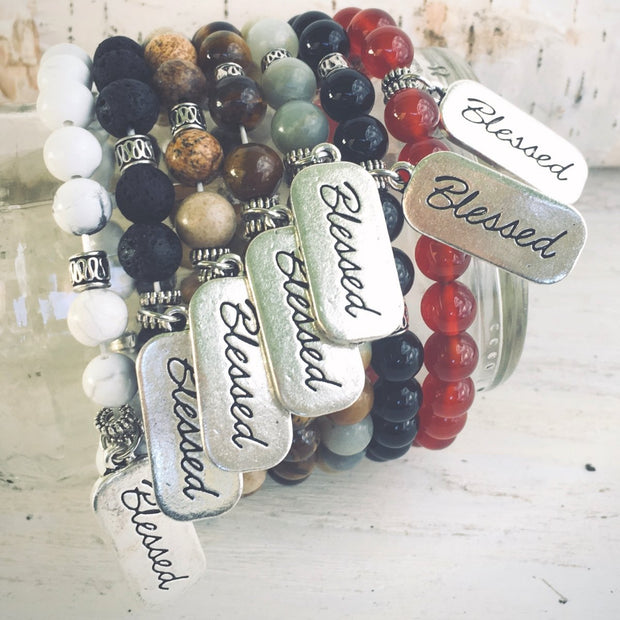 photo of all the Blessed natural stone bracelet variants displayed around a jar