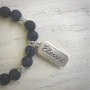 close-up of the front of the blessed charm and lava stone beads