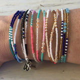 photo of a arm with all the different seed bead bracelet options displayed