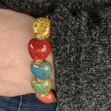 Close-up of the Colorful 'His Steadfast Love' Ceramic Heart bead Bracelet worn on Model's wrist