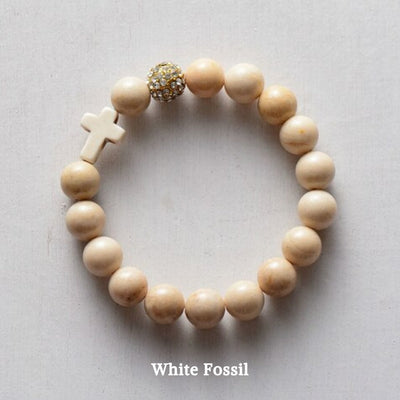 product top-view of the 'Thou Art With Me' White Fossil Natural Stone  with Ivory Cross Bead Bracelet