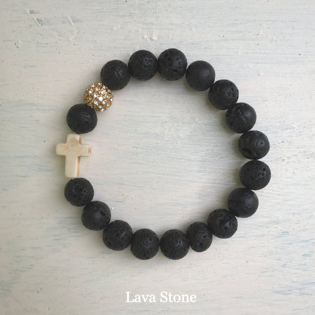 product top-view of the Natural Stone 'Thou Art With Me' Lava Stone with Ivory Cross Bead Bracelet - Orignal style that has a sparkly pave ball