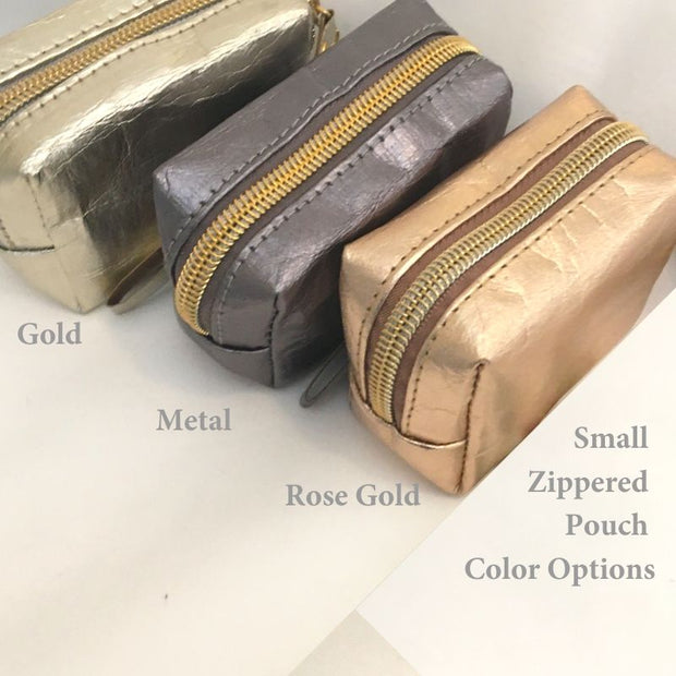 photo of the 3 zippered min-pouch options — Gold, Rose Gold, and Silver
