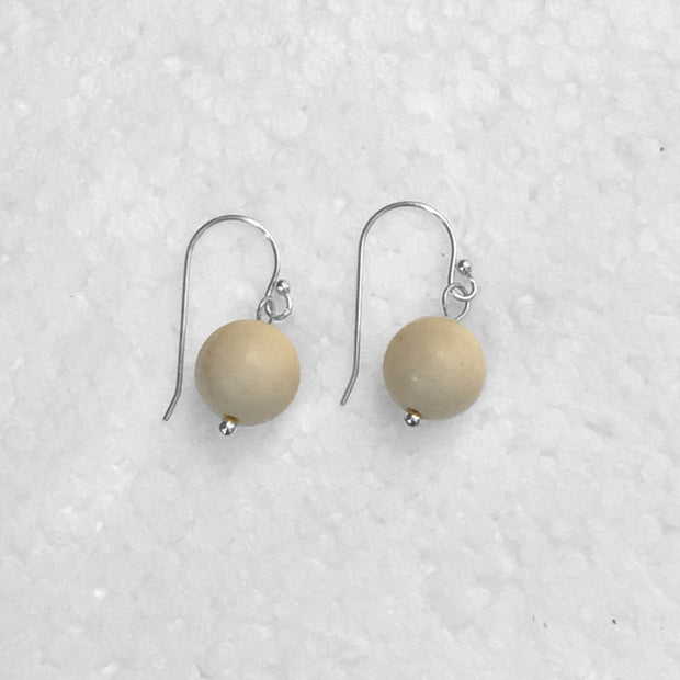 close-up of the  Natural Stone Blessing Earrings—White Fossil bead and Sterling Silver Hook