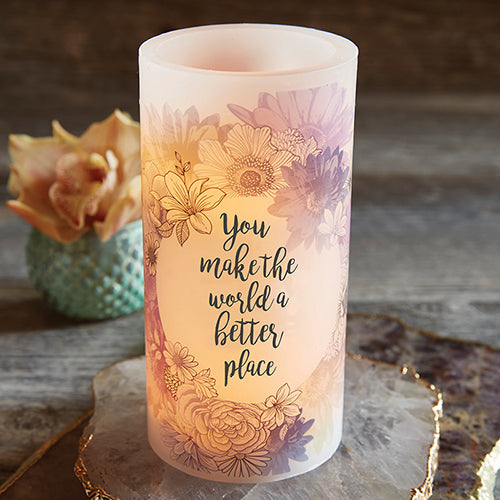 Front view of the LED Candle with Scripture Verse You make the world a better place surrounded by decor