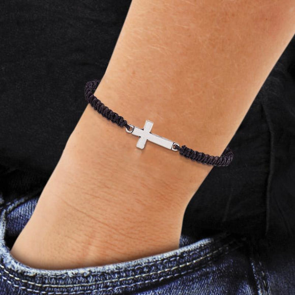 Photo of the black ' I Can Do All Things ' corderd Cross Bracelet on mans wrist