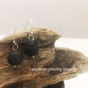 close-up of the Natural Stone Blessing Earrings—Lava Stone bead and Sterling Silver Hook