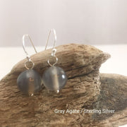 close-up of the Natural Stone Blessing Earrings—Gray Agate bead and Sterling Silver Hook