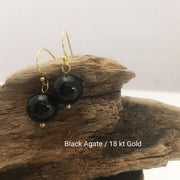 close-up of the Natural Stone Blessing Earrings—Black Agate bead and Sterling Silver Hook plated in 18k gold