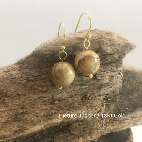close-up of the Natural Stone Blessing Earrings—Picture Jasper bead and Sterling Silver Hook plated in 18k gold