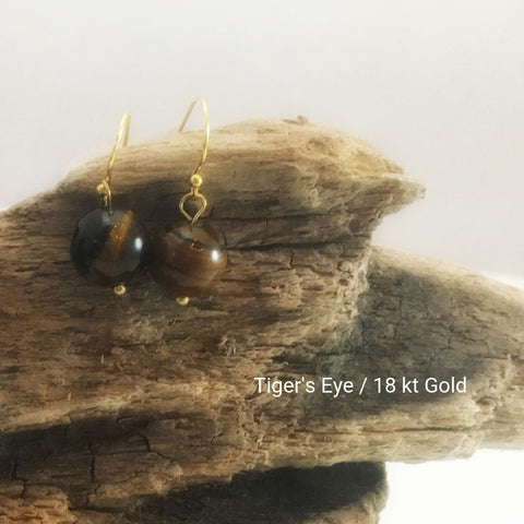 close-up of the Natural Stone Blessing Earrings—Tiger's Eye bead and Sterling Silver Hook plated in 18k gold