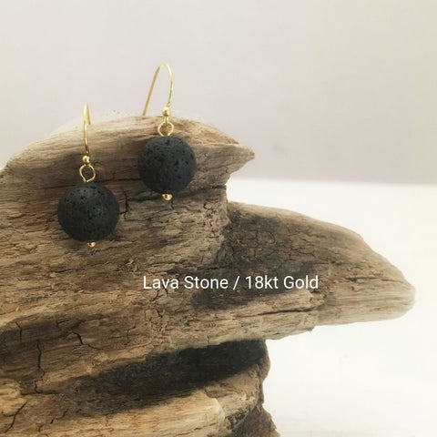 close-up of the  Natural Stone Blessing Earrings—Lava Stone bead and Sterling Silver Hook plated in 18k gold