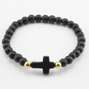 top view of the Black ' jesus loves me' Youth bead bracelet with black cross