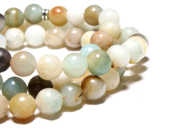 very close-up of the Tree of Life Wrap Amazonite Beads  on white background