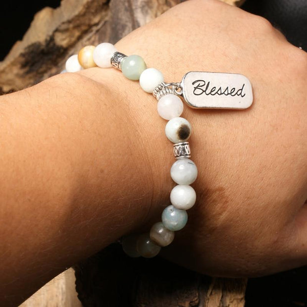 close-up of the blessed bracelt on Models wrist