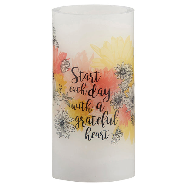 Front view of the LED Candle product with Scripture Verse Start your day with a grateful heart against white background