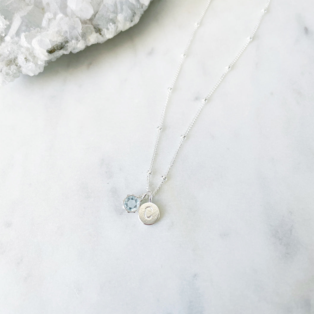 Aquamarine necklace in sterling silver with initial tag